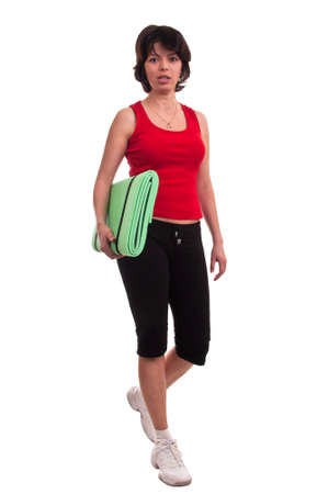 Beautiful young woman holding exercise mat - getting ready for exercise photo