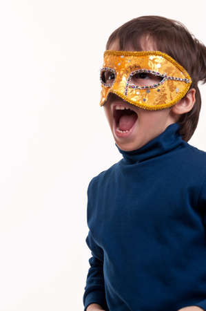 Little boy wearing a gold carnival mask, pretending to be a superhero Stock Photo - 19167212