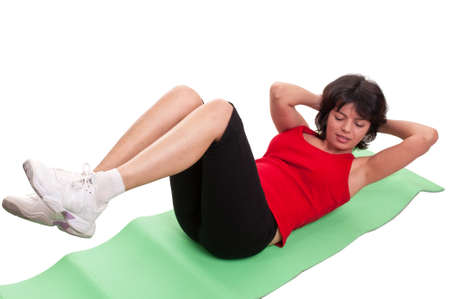 Young woman doing exercise for abs isolated on white background