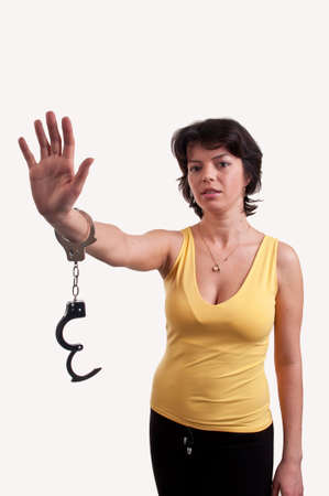 Beautiful woman with handcuffs photo