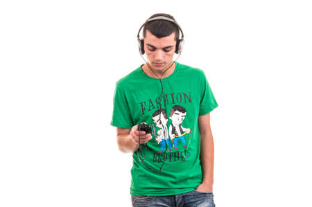 Casual young man listening music with headphones connected at smartphone Stock Photo