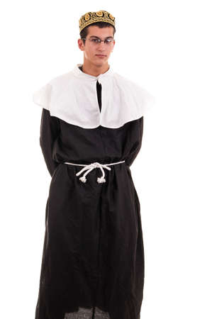 funny young man costumed in nun for fun photo