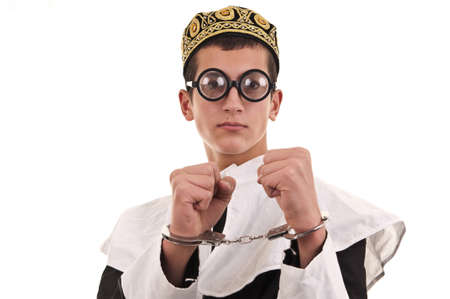 young man with handcuffs costumed in nun for fun, funny religious concept photo