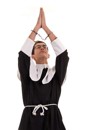 young man with handcuffs costumed in nun for fun, funny religious concept Stock Photo - 19407315
