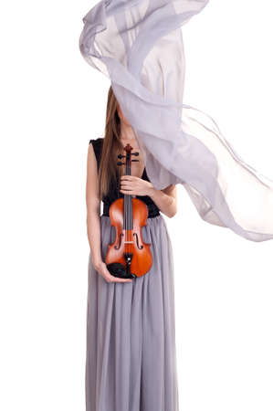 young woman with violin in hands and a beautiful silk scarf blown by the wind covers her face Stock Photo