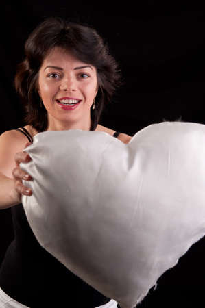 a beautiful young woman with a white heart in hand photo