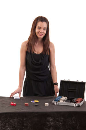beautiful girl dealer behind a table for game in poker on white background photo