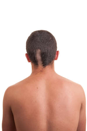 Closeup of the back of man head while his hair is cut isolated on white photo