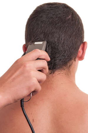 hair clippers: Man having a haircut with a hair clippers over a white background