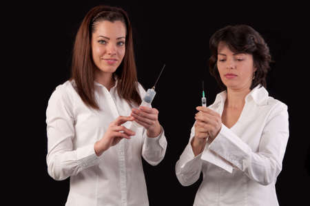female doctor and hurse preparing to give an injection Stock Photo - 19799953
