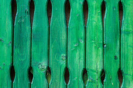 Close up of green wooden fence panels