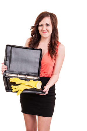 houseclean: funny picture of young business woman hiding her yellow rubber gloves in a briefcase