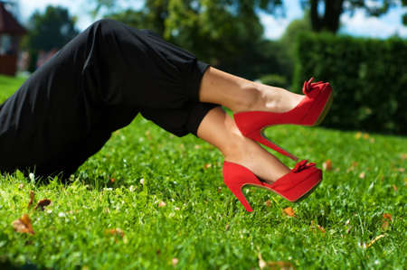 Picture legs of young girl on green grass photo