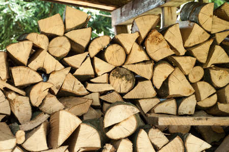 Pile of chopped firewood ready for winter, wood stack Stock Photo