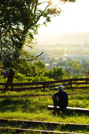 man sitting on a bench photo