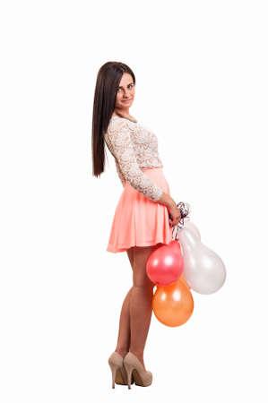 Joven mujer de cuerpo completo con globos como un regalo para la fiesta de cumpleaños sonriendo y mirando a la cámara Foto de archivo - 19984843
