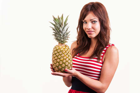 Young cheerful smiling healthy and joyful woman with big pineapple