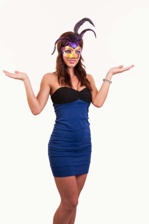 Beautiful young woman with a mask showing with hands - place for your product