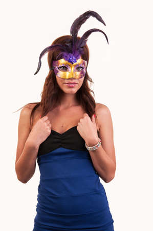 Beautiful young woman in a purple carnival mask, masquerade photo