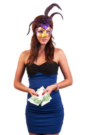 Beautiful young woman in purple mysterious venetian mask posing with money in her hands