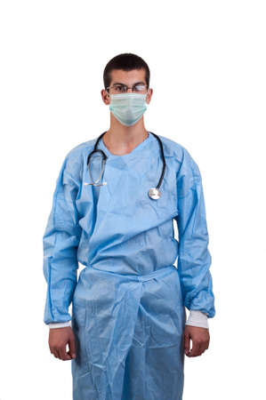 surgeon wearing blue scrubs and mask photo
