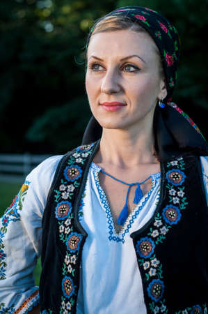 close up of young beautiful singer posing in traditional costume, romanian folklore Stock Photo - 20896743