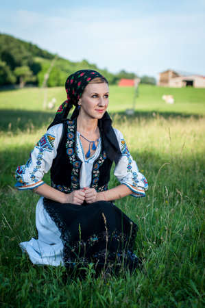 Young beautiful singer posing in traditional costume, romanian folklore Stock Photo - 20896748
