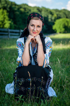 Portrait of young beautiful woman posing in Romanian traditional costume Stock Photo - 20896749