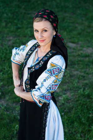 Young beautiful singer posing in traditional costume, romanian folklore Stock Photo - 20896751