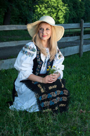 Portrait of young beautiful singer posing in traditional costume, romanian folklore Stock Photo - 20896771