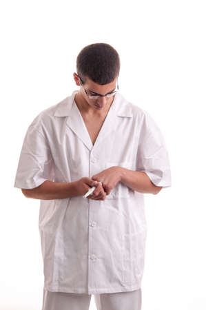 Closeup of young doctor injecting medicine in his hand photo