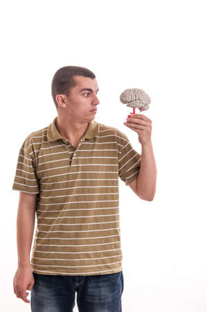 Man holding a human brain model and looked at him