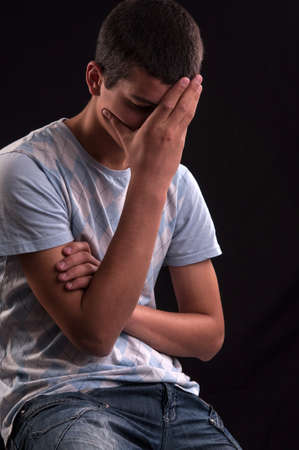 Upset caucasian teen with hand on head