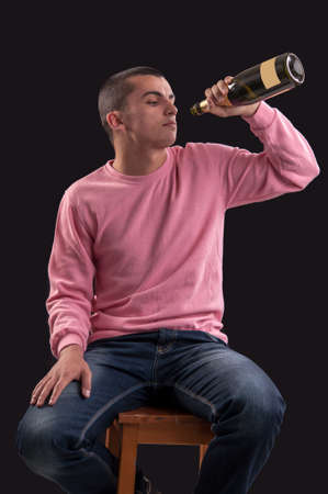 drinking alcohol: Young man drinking alcohol