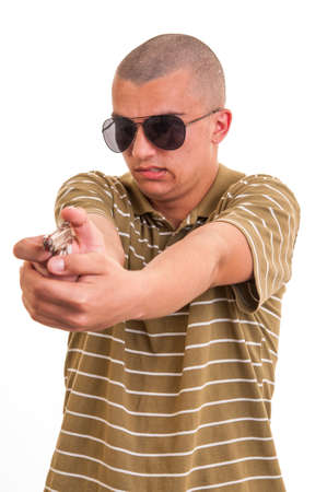 handsome young man pointing with toy gun isolated on white