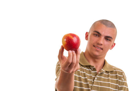 Closeup portrait of a healthy young man holding and offering an apple as a healthy alternative for food