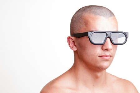 body dimensions: portrait of serious young man wearing 3D glasses