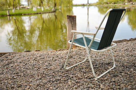 chair at shore of a lake, perfect place for relaxing and meditation