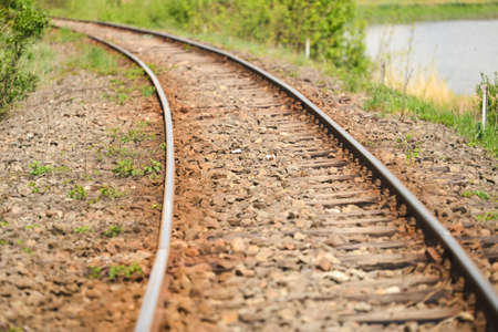 railtrack: detail of an old railway that runs along a lake in the country