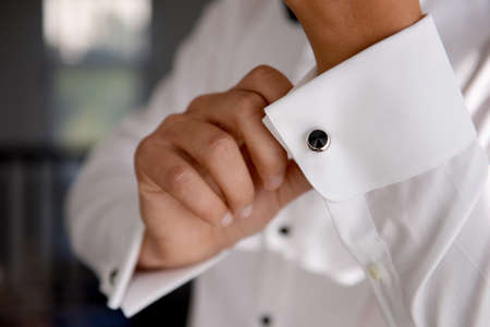 close   up: close up of a hand man how wears white shirt and cufflink