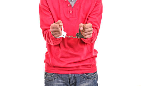 confiscation: young man with pink blouse handcuffed
