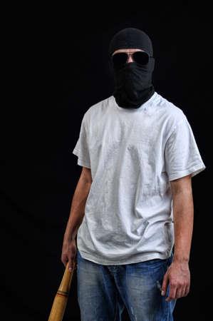 desperado: Masked man preparing to attack with bat