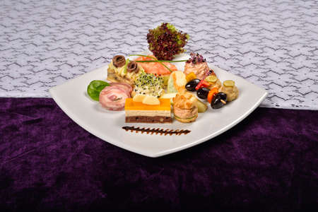 appetizers menu: Antipasto and catering platter with different appetizers, restaurant menu