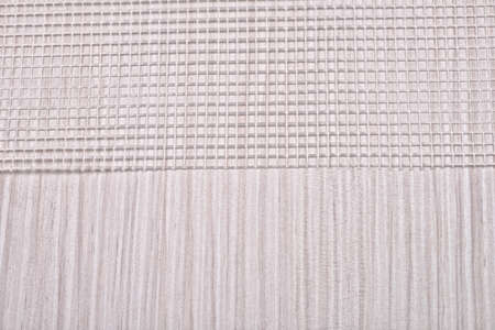 plastic backdrop: close up of plastic mesh on a wood panel