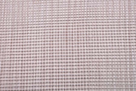 wood panel: close up of plastic mesh on a wood panel