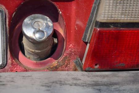 rusty car: Close up of rusty car gasoline fill cap Stock Photo