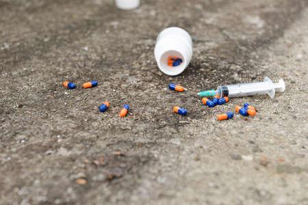 sobredosis: Drug overdose concept - pills and injection Foto de archivo