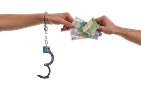 fettered: Hand of a man in handcuffs giving bribe Stock Photo
