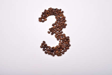 morning coffee: Number three from coffee beans isolated on white background. Love coffee. Morning pleasure Stock Photo