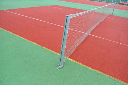 untidy: close-up view of a rubber broken tennis net. Untidy land